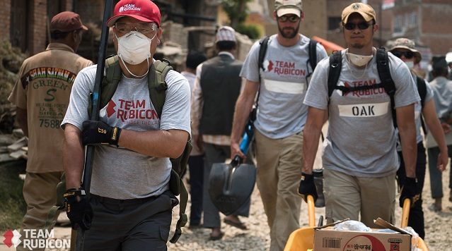 Team Rubicon rolls in with gear to clean up an area on the outskirts of Kathmandu.