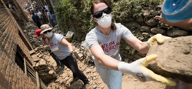 Team Rubicon member Sarah Terez Malka takes a well kept brick to be used for later in a rebuild.